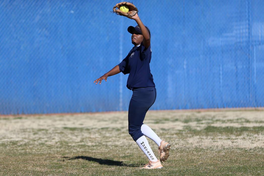 Shadow Ridge's Jasmine Martin, 17, catches the ball during a softball practice at Shadow Ridge ...