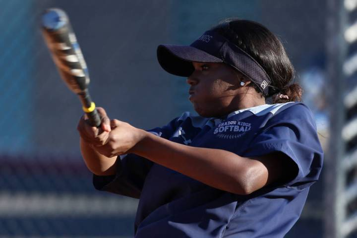 Shadow Ridge's Jasmine Martin, 17, connects with the ball during a softball practice at Shadow ...