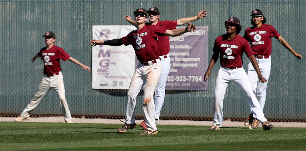 Desert Oasis baseball players warm up during a light practice at the school in Las Vegas Wednes ...