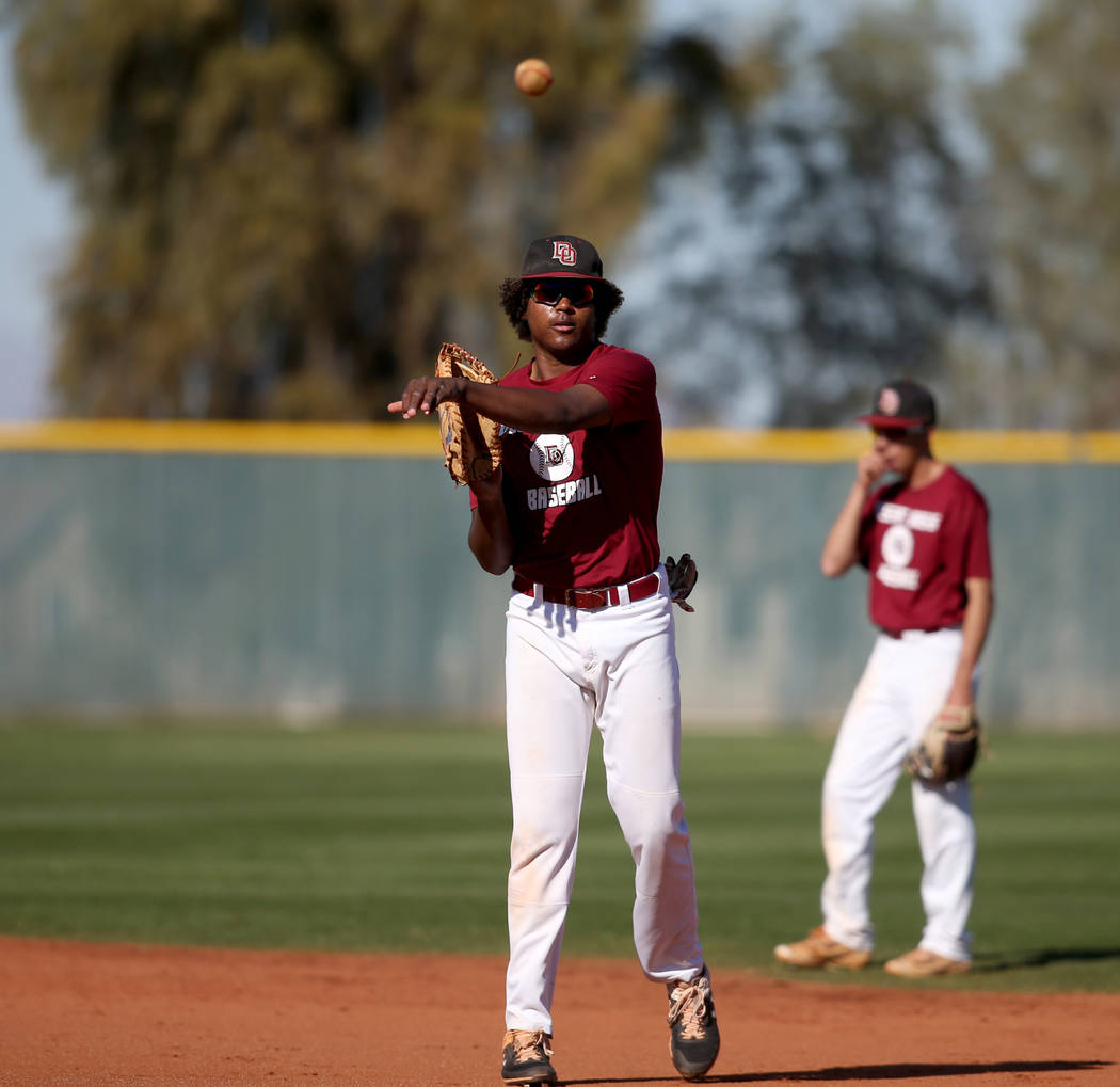 Desert Oasis first baseman Jake Walsh tosses the ball in during batting practice at the school ...