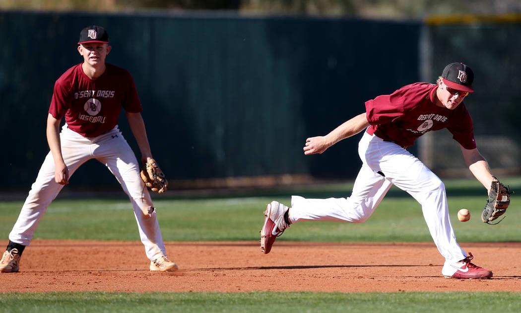 Desert Oasis third baseman Colton Zobrist fields the ball during batting practice at the school ...