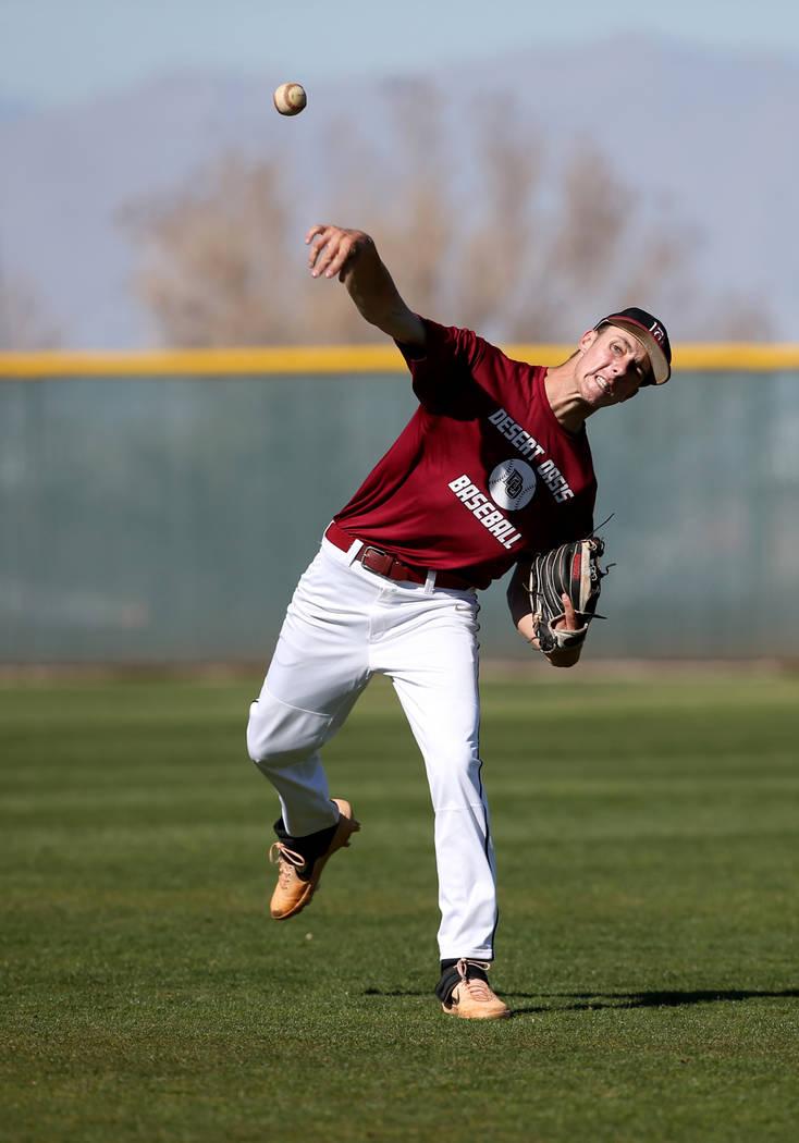 Desert Oasis pitcher Tyler Stott tosses the ball in during batting practice at the school in La ...