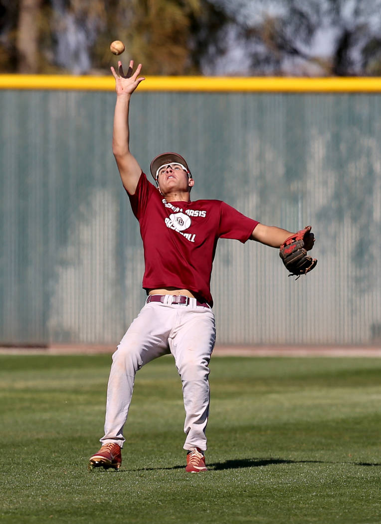 Desert Oasis Jacob Baca catches the ball during batting practice at the school in Las Vegas Wed ...