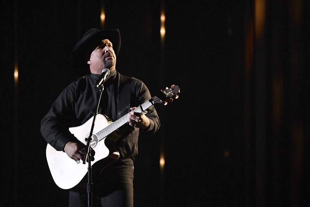 "Garth Brooks performs ""Stronger Than Me"" at the 52nd annual CMA Awards at Bridgestone ..."