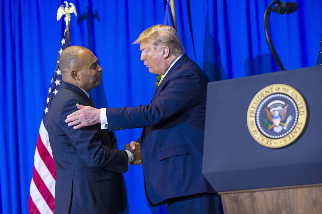 President Donald Trump, right, talks with Hope for Prisoners CEO Jon Ponder during a graduation ...