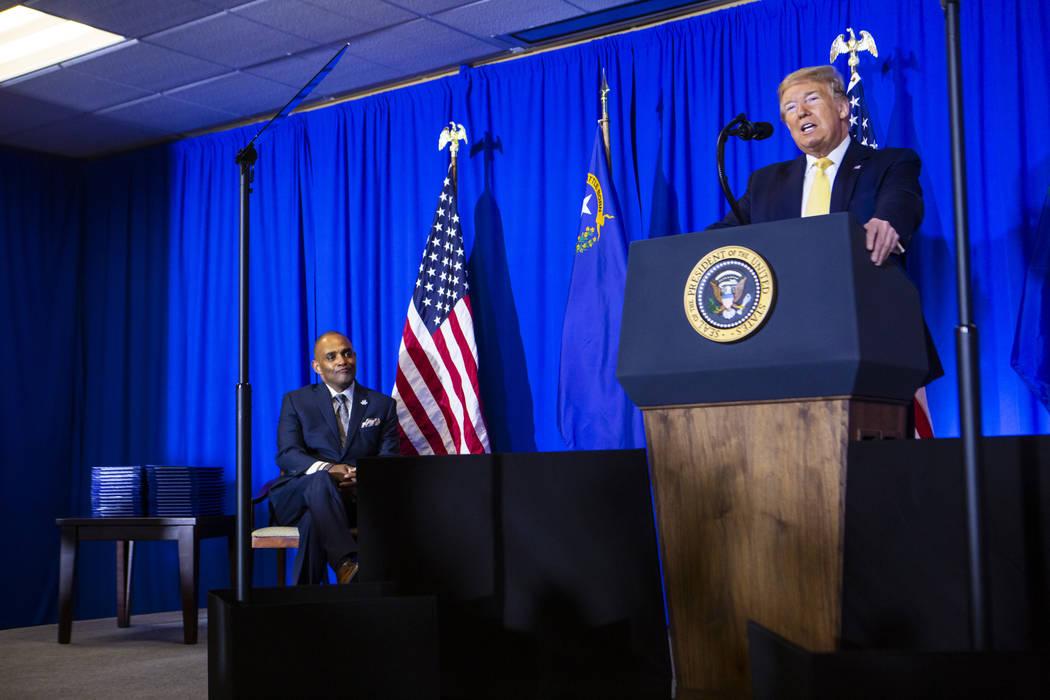 President Donald Trump speaks as Hope for Prisoners CEO Jon Ponder, left, looks on during a gra ...