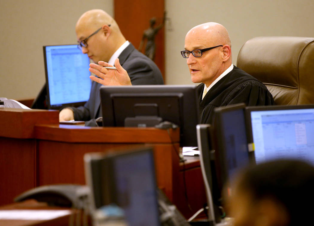 Clark County District Judge Rob Bare presides during a hearing at the Regional Justice Center i ...