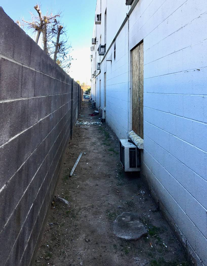 In January, the north side of the Alpine Motel Apartments in downtown Las Vegas showed plywood ...
