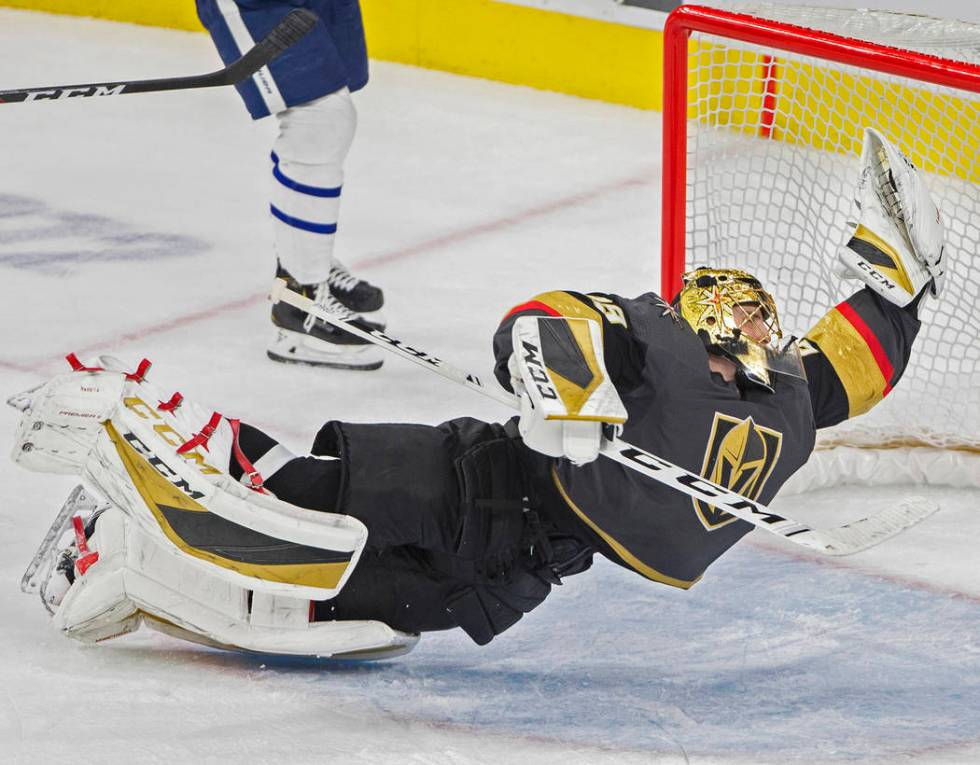 Vegas Golden Knights goaltender Marc-Andre Fleury makes a diving save in the third period again ...