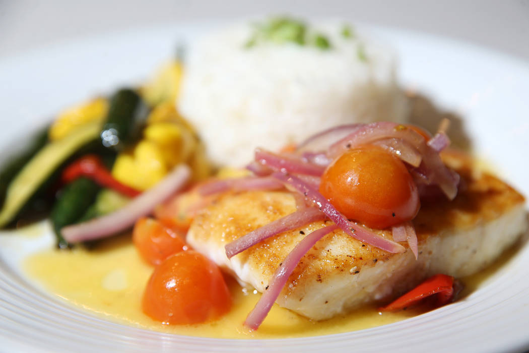 The pacific halibut served with tomato and red onion salad, steamed rice and beurre blanc sauce ...