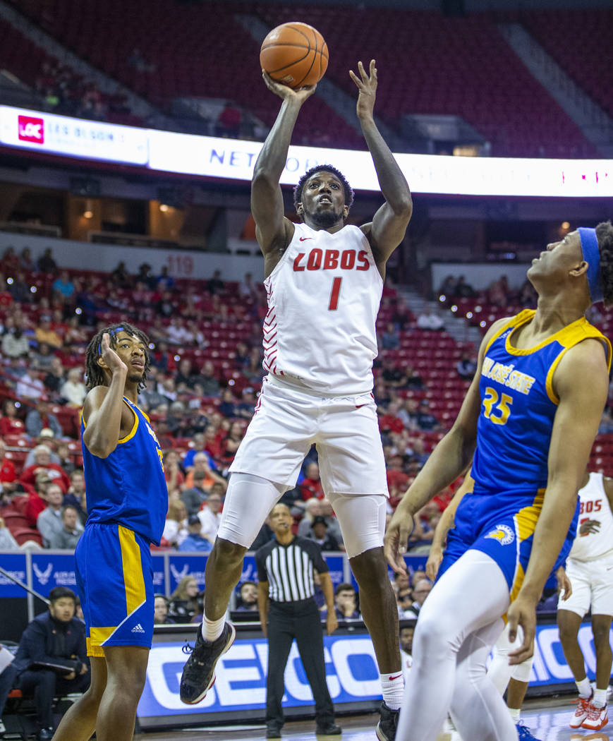 New Mexico Lobos forward Corey Manigault (1) looks to shoot between the San Jose State Spartans ...
