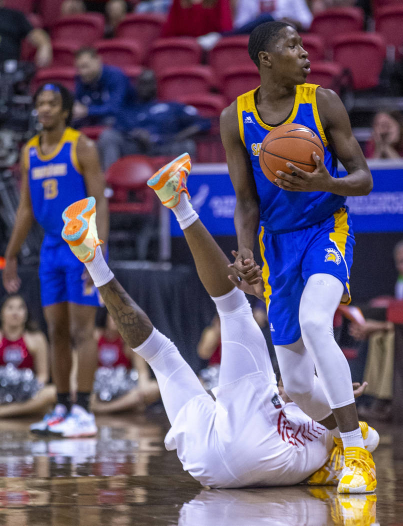 San Jose State Spartans guard Omari Moore (10, above) looks for the foul call as New Mexico Lob ...