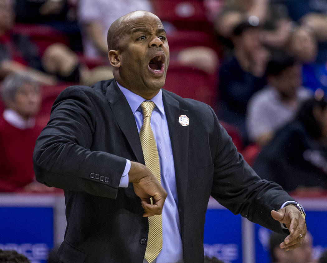 The San Jose State Spartans head coach Jean Prioleau calls in another play in their first half ...
