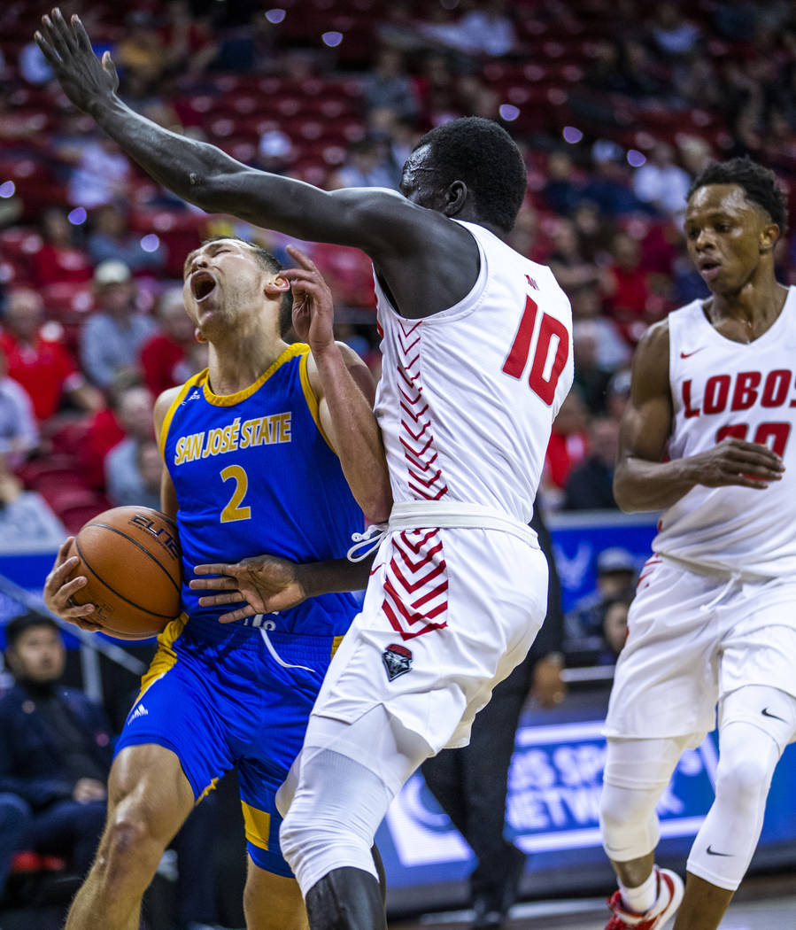 San Jose State Spartans guard Brae Ivey (2, left) takes a charge from New Mexico Lobos guard Ma ...
