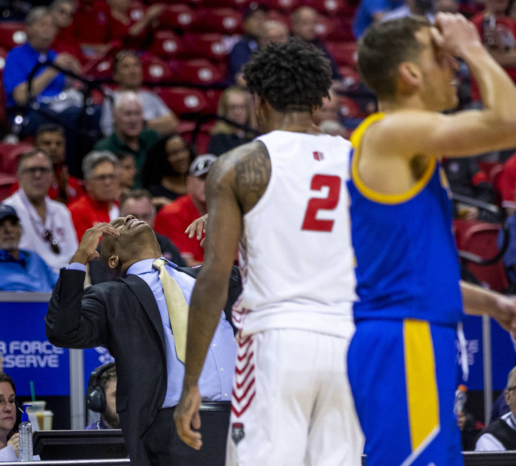 The San Jose State Spartans head coach Jean Prioleau, left, reacts to a foul call in their firs ...