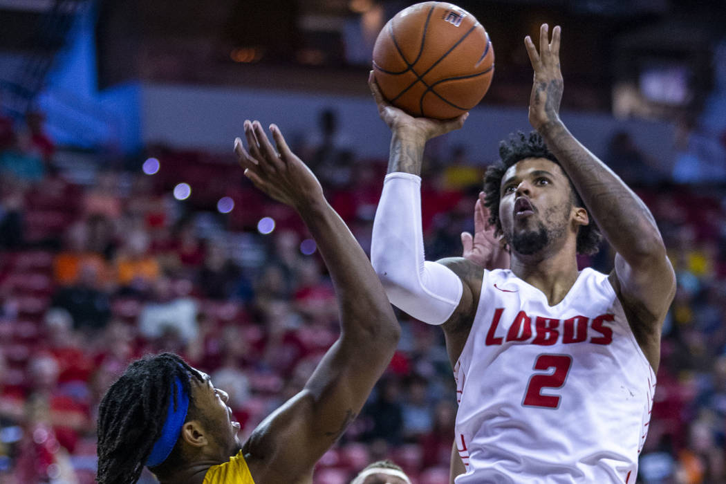 New Mexico Lobos guard Vance Jackson (2), right, gets off a jump shot between San Jose State Sp ...