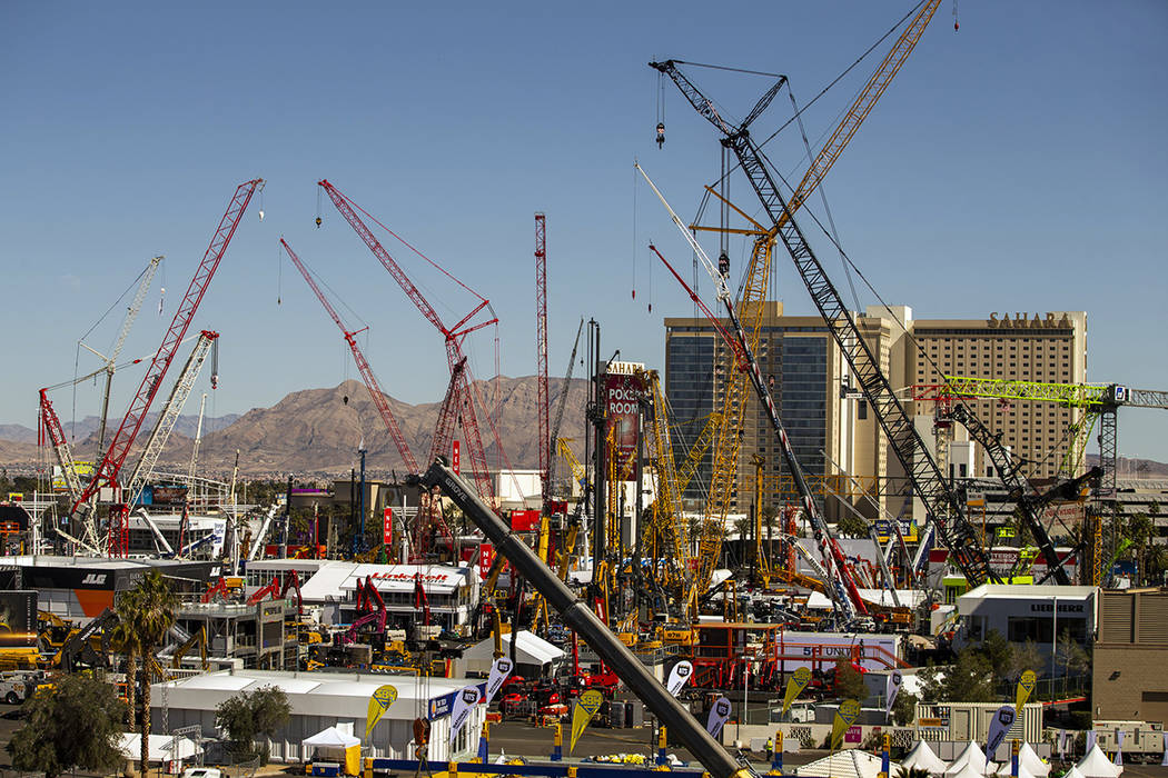 Numerous construction cranes and equipment are in place for the upcoming CONEXPO-CON/AGG event ...