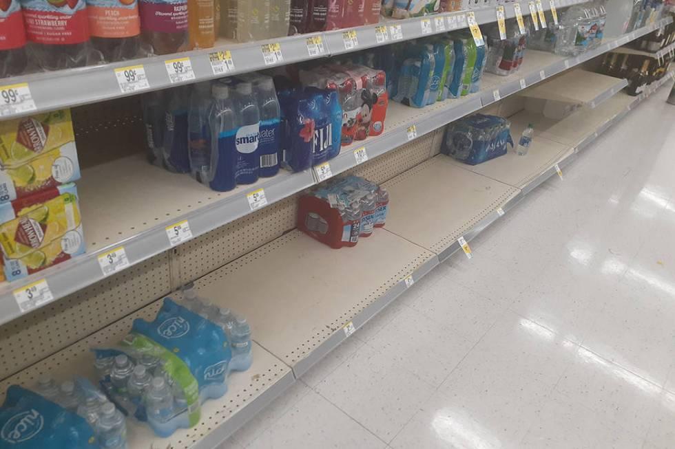The bottled water aisle at Walgreens, 2389 E. Windmill Lane in Las Vegas. (Tony Garcia/Las Vega ...