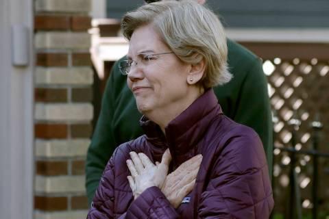 Sen. Elizabeth Warren, D-Mass., acknowledges supporters as she arrives to speak to the media ou ...