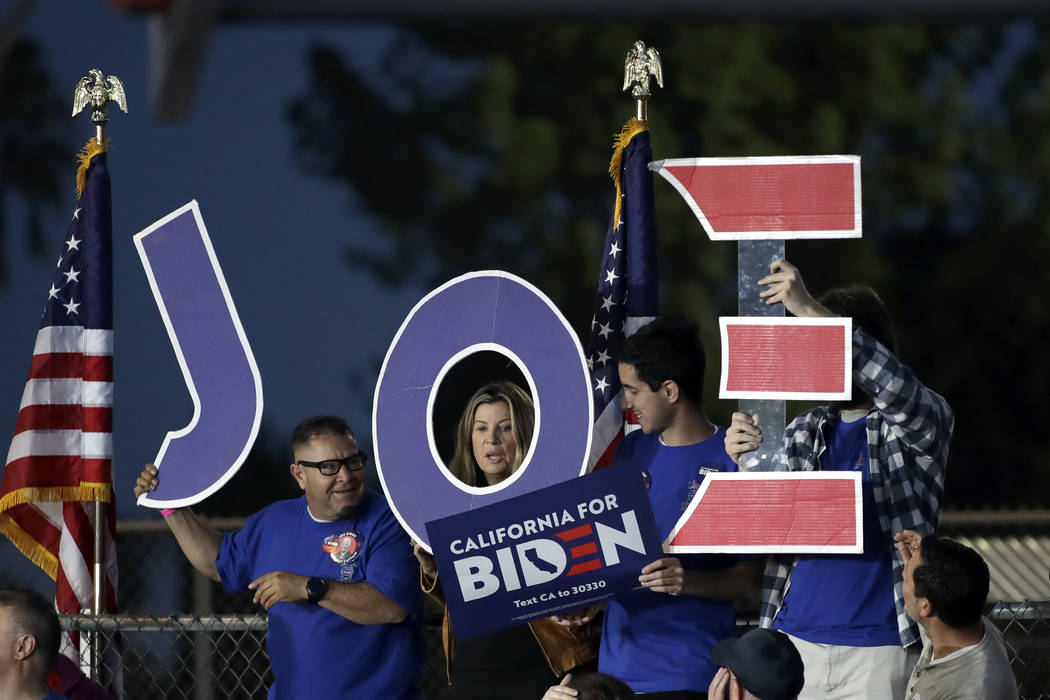 Supporters hold a sign before a campaign rally for Democratic presidential candidate former Vic ...