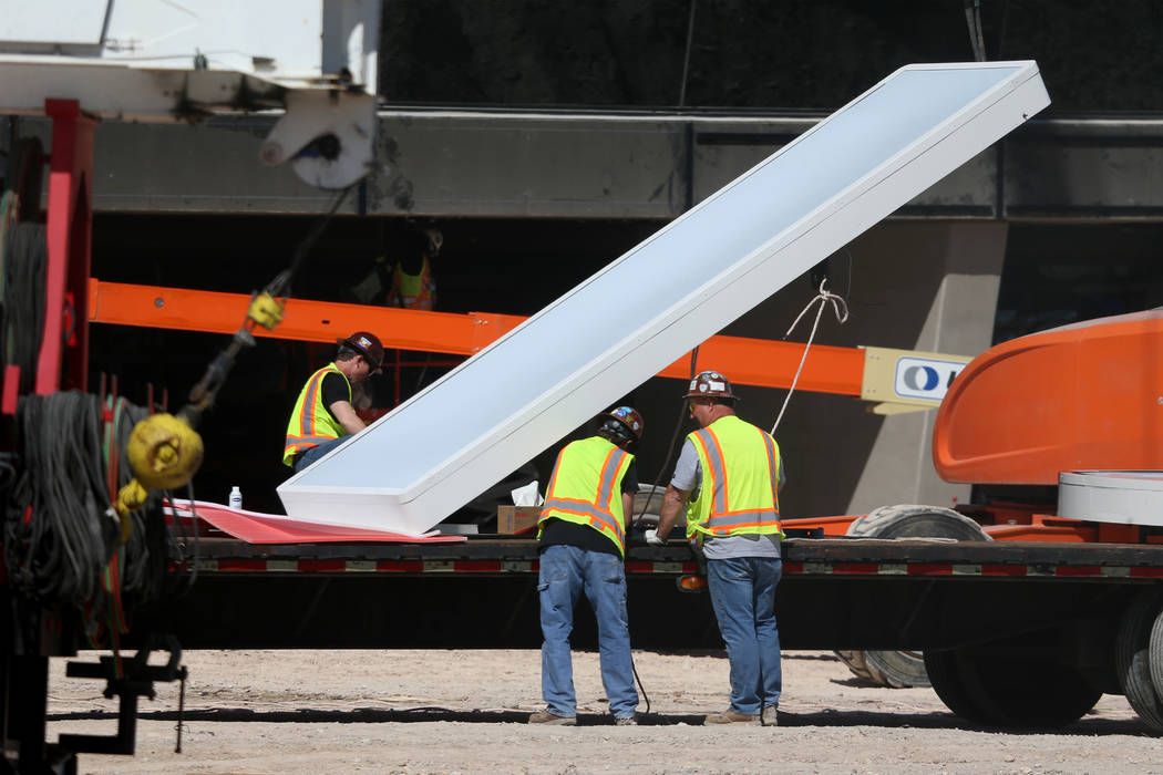 The sign at the Raiders Allegiant Stadium in Las Vegas gets prepared to be installed, Thursday, ...