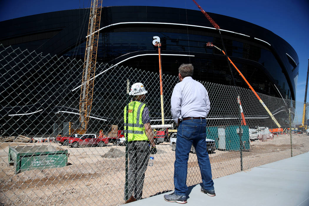 The sign gets installed at the Raiders Allegiant Stadium in Las Vegas, Thursday, March 5, 2020. ...