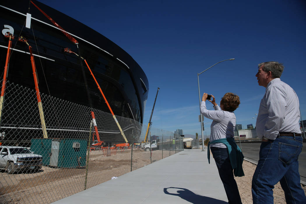 Sharon Miller, left, and her brother John Meesig of Ohio, document the signage getting installe ...