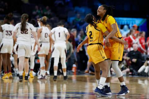California's Cailyn Crocker (2) and Jaelyn Brown celebrate after defeating Arizona State in an ...