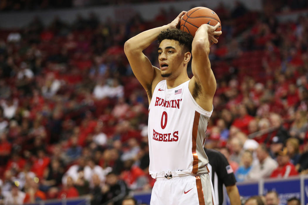 UNLV Rebels guard Jay Green (0) looks for an open pass against Boise State Broncos during the f ...
