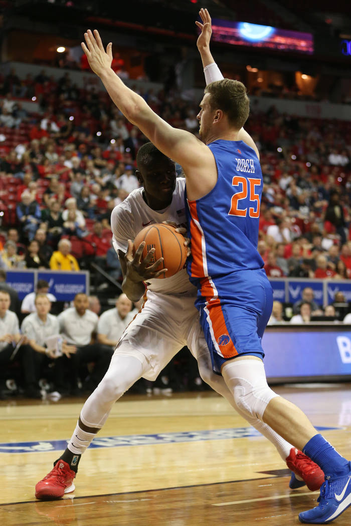 UNLV Rebels forward Cheikh Mbacke Diong (34) is pressured by Boise State Broncos center Robin J ...