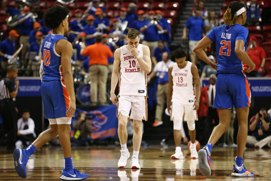UNLV Rebels guard Jonah Antonio (10) followed by guard Bryce Hamilton (13) leave the court afte ...