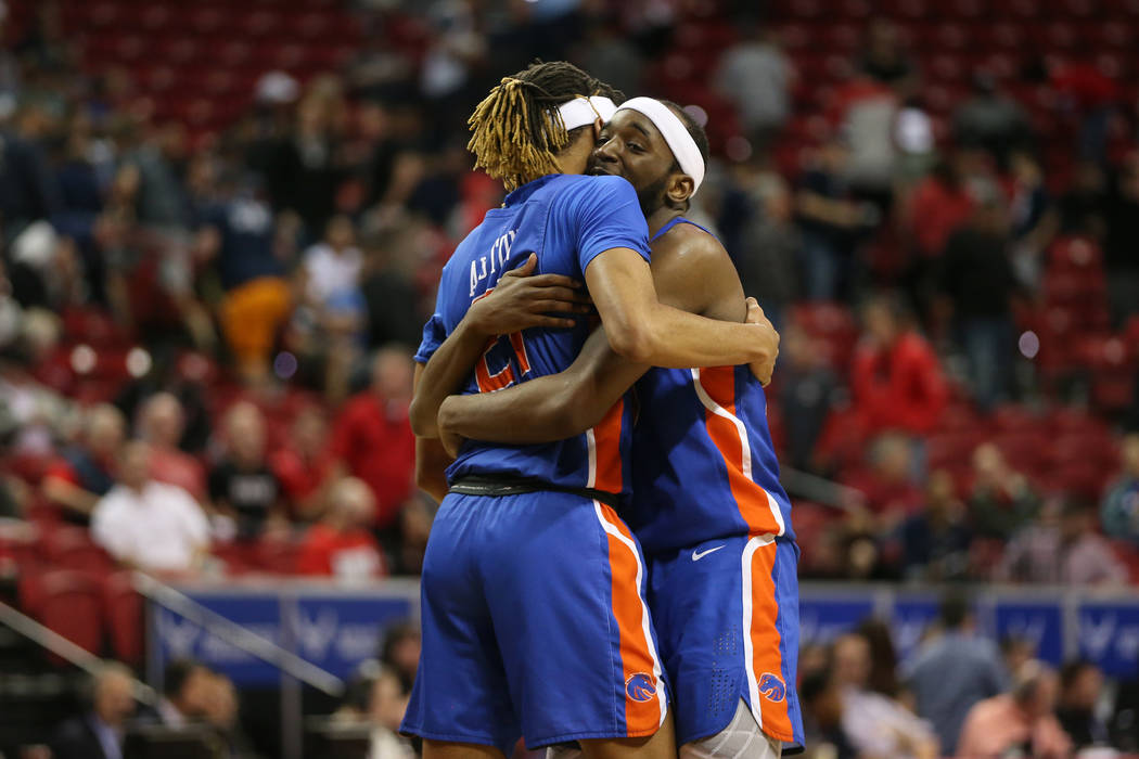 Boise State Broncos guard Derrick Alston (21) and forward RJ Williams (23) embrace after their ...