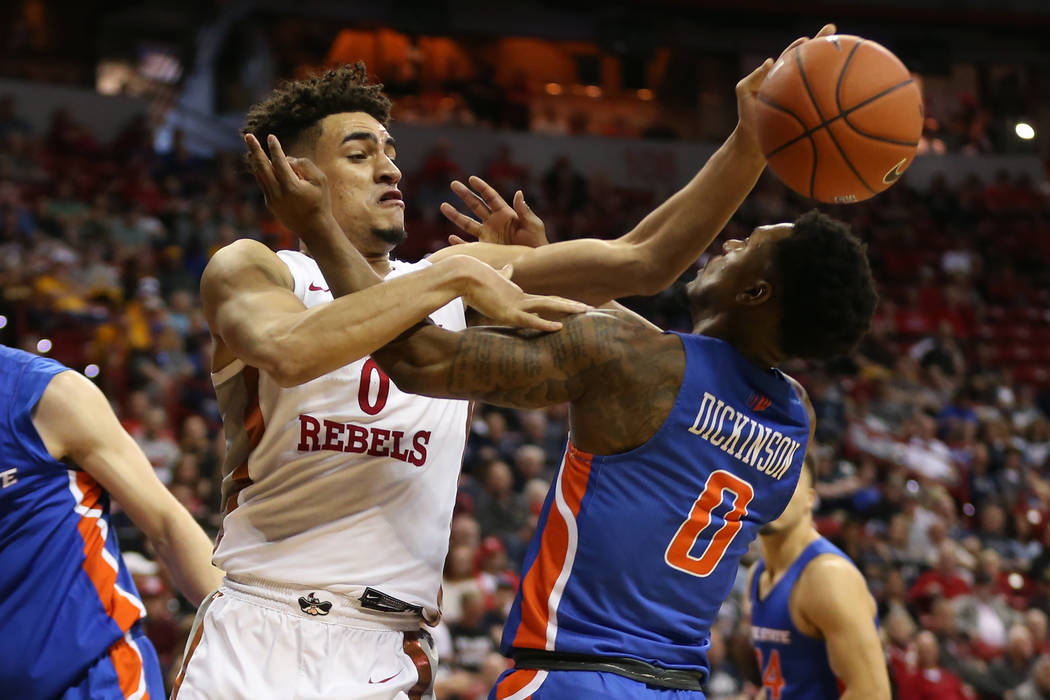 UNLV Rebels guard Jay Green (0) battles for a loose ball against Boise State Broncos guard Marc ...