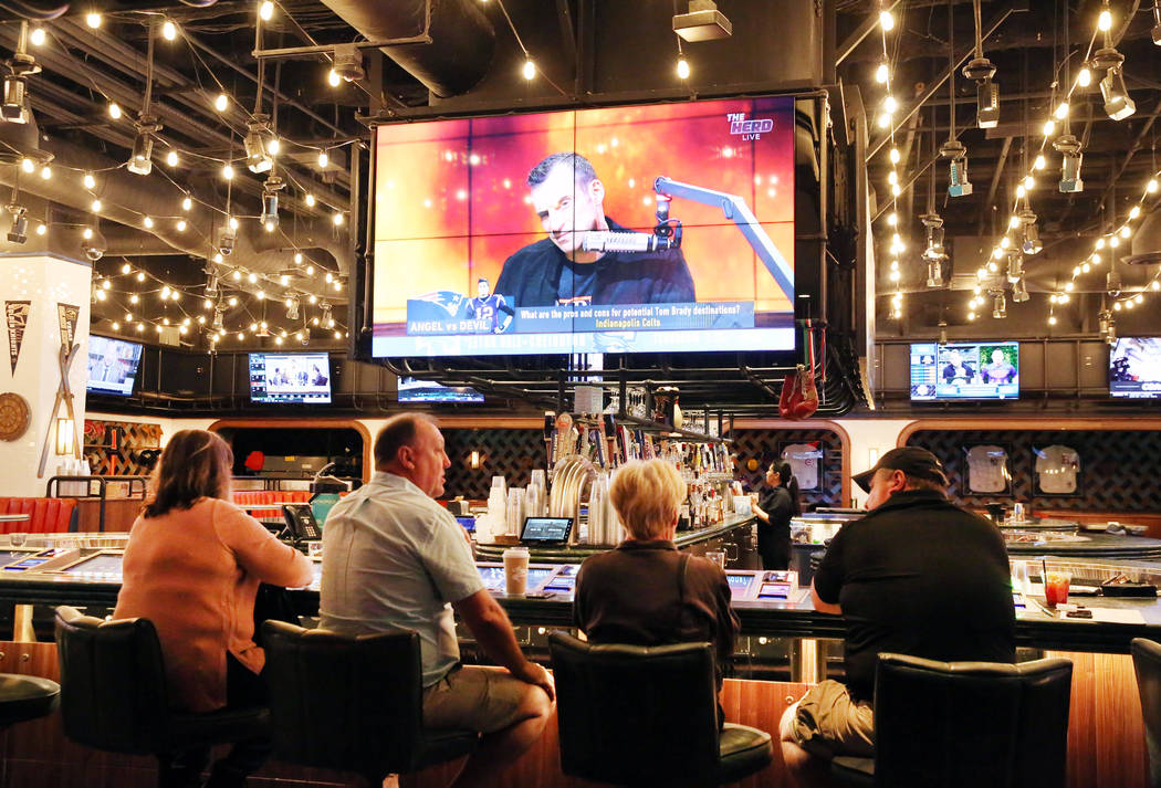 Patrons play video game at the new sportsbook at Park MGM on Friday, March. 6, 2020, in Las Veg ...