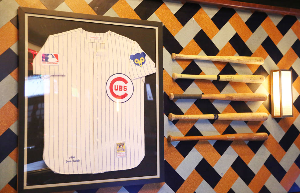 Baseball jersey and batts are displayed at the new sportsbook bar at Park MGM on Friday, March. ...