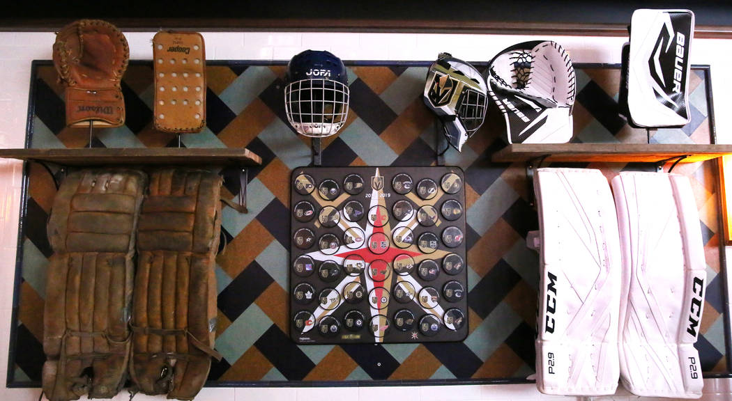 Old hockey gear are displayed at the new sportsbook bar at Park MGM on Friday, March. 6, 2020, ...