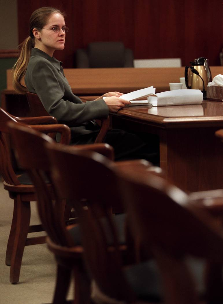 Jessica Williams waits alone as all of the attorneys were in a closed door hearing with Judge G ...