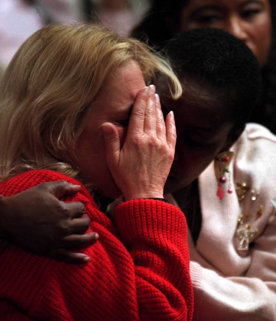 Brigitte Smith, right, comforts Joetta Burke while the prosecution show photos of their childre ...