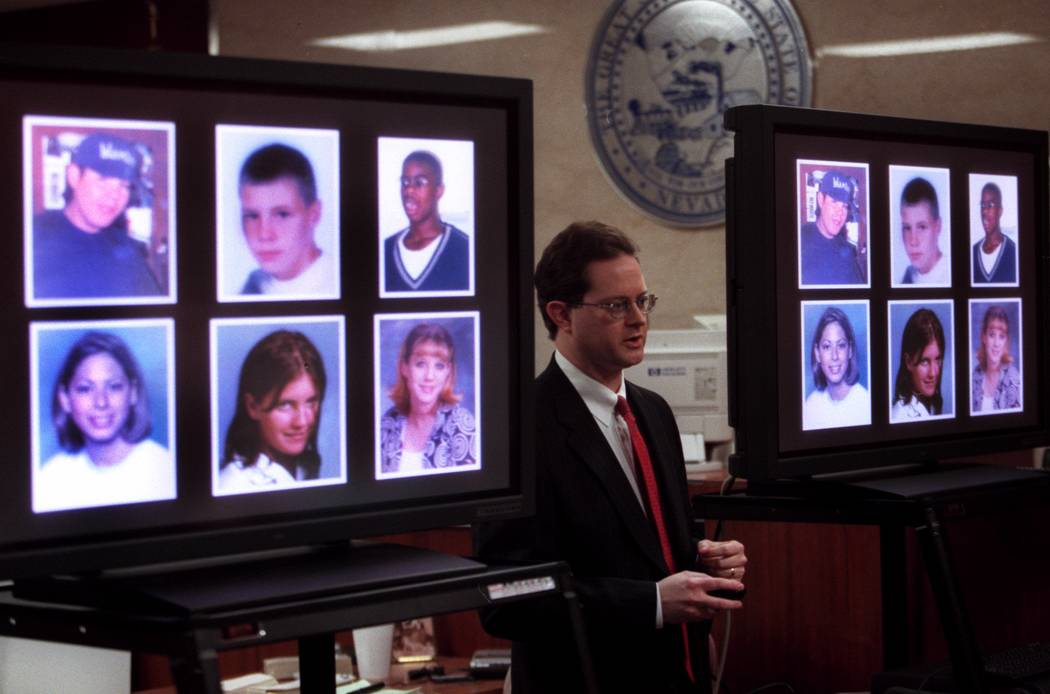 Prosecutor Jim Hartsell shows the victims of the accident to the jury during closing on argumen ...