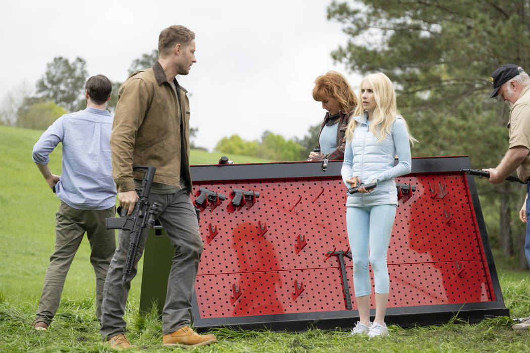 Members of the hunted (from left, Ike Barinholz, back to camera, Justin Hartley, Kate Nowlin), ...