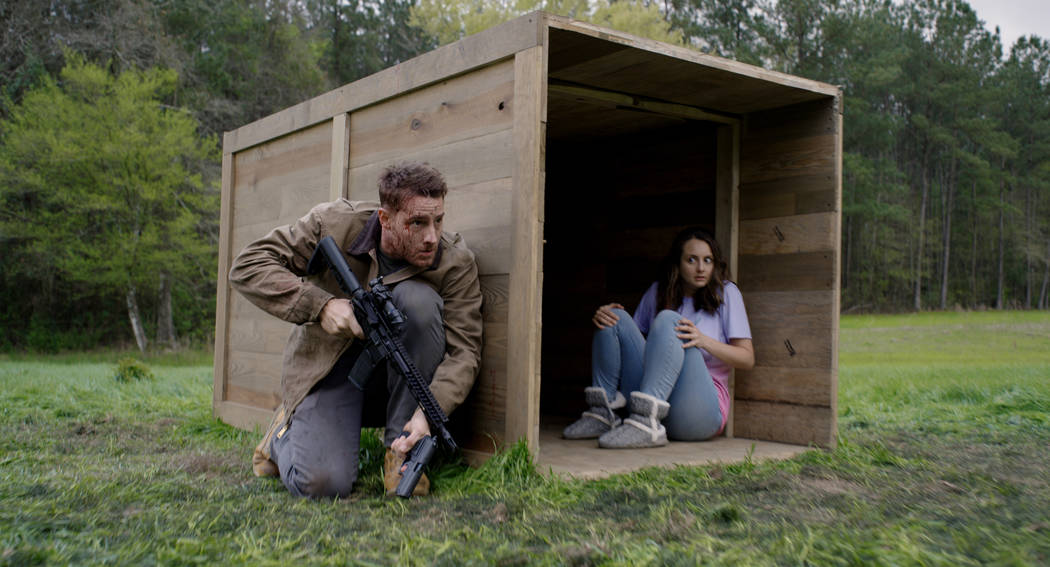 Members of the hunted (from left, Justin Hartley, Sylvia Grace Crim) in The Hunt, directed by C ...