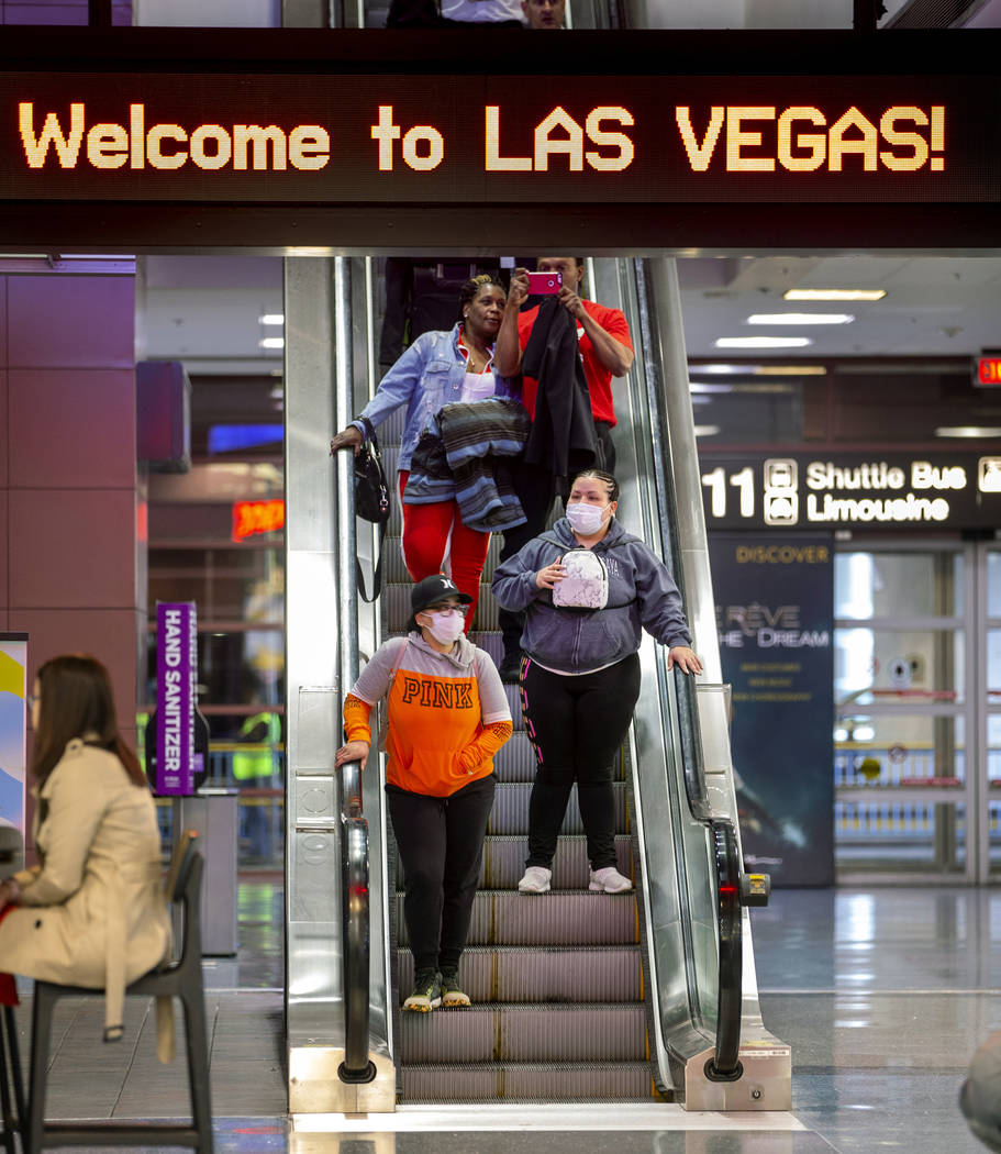 Passengers Sherry Carter, left, and Kimberly Thompson of Virginia wear face masks while arrivin ...