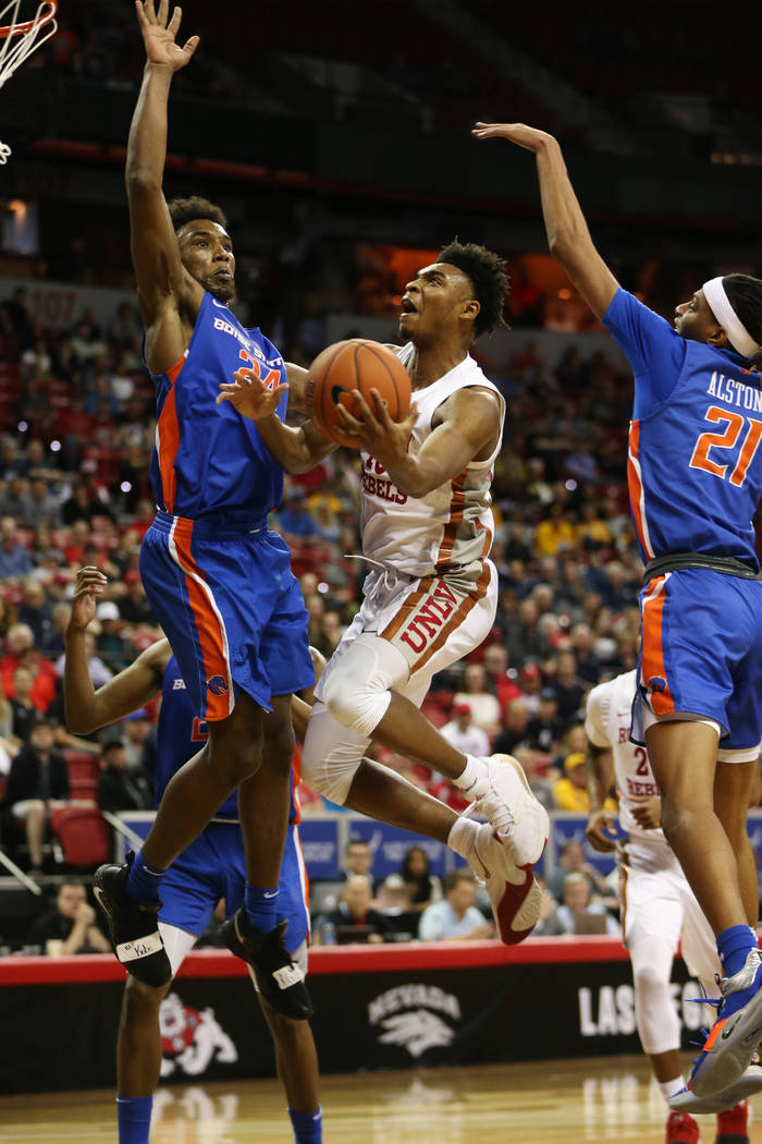 UNLV Rebels guard Bryce Hamilton (13) goes up for a shot against pressure from Boise State Bron ...