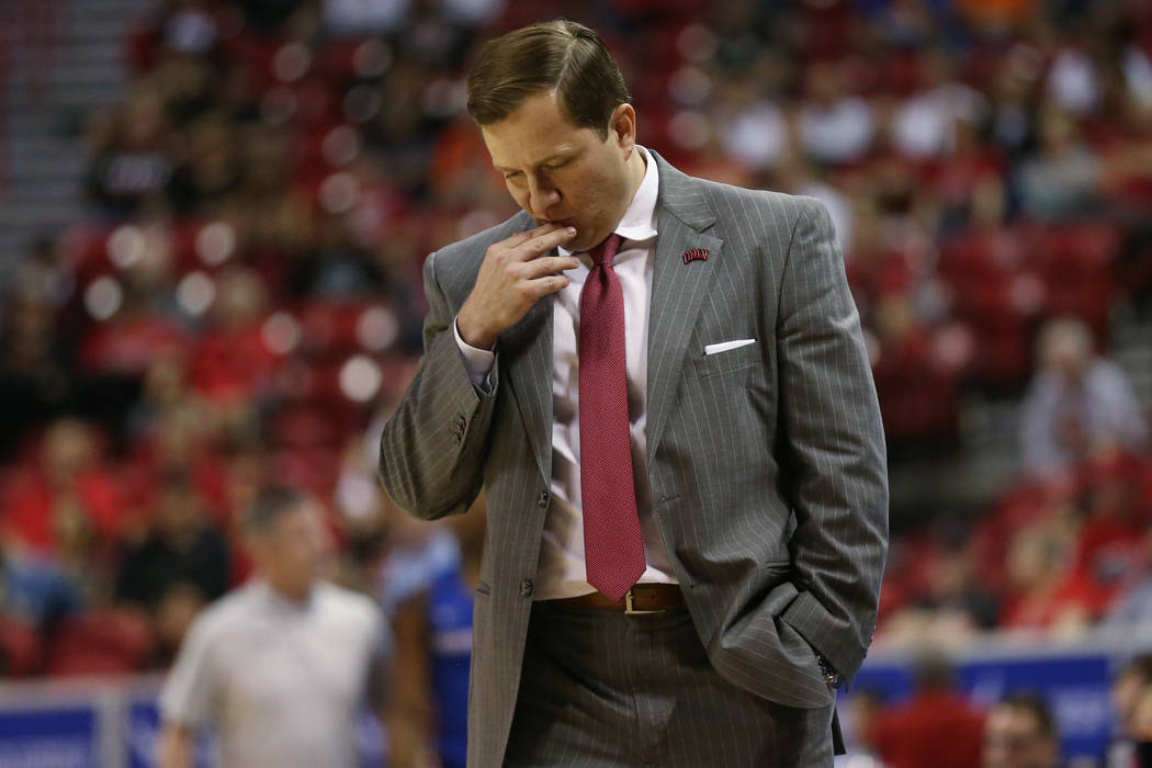UNLV Rebels head coach T. J. Otzelberger reacts after a play against Boise State Broncos during ...