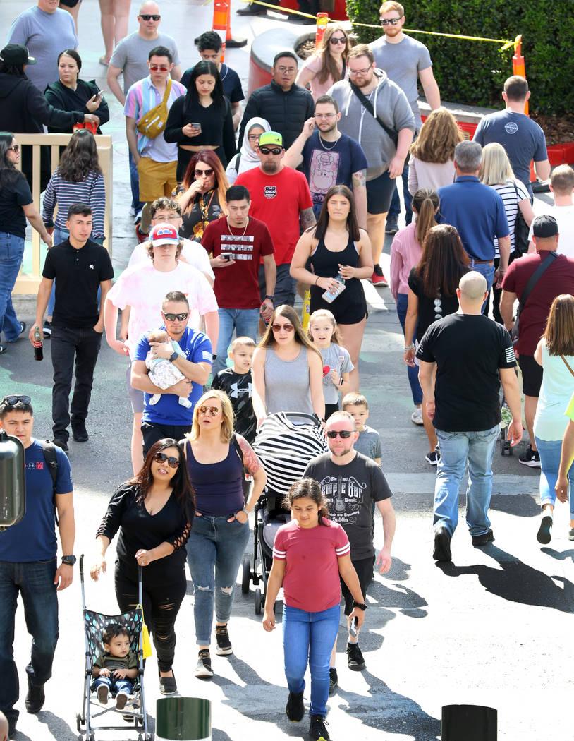Tourists walk along Las Vegas Boulevard on Friday, March 6, 2020, in Las Vegas. (Bizuayehu Tesf ...