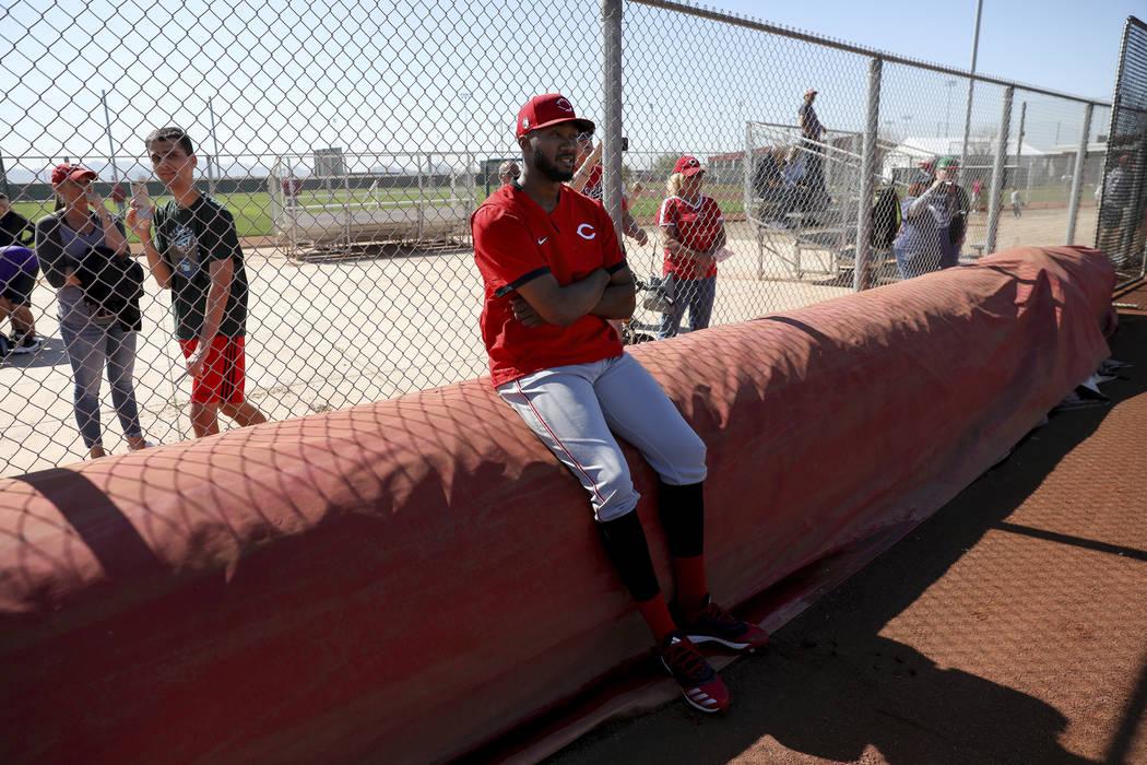 Cincinnati Reds pitcher Amir Garrett (50) takes a seat on a tarp, Saturday, Feb. 15, 2020, at t ...