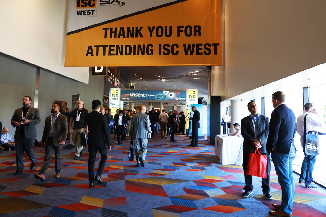 Attendees browse through the International Security Conference & Exposition, also known as ISC ...