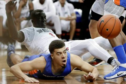Boise State's Alex Hobbs (34) and San Diego State's Aguek Arop (3) go for a loose ball during t ...
