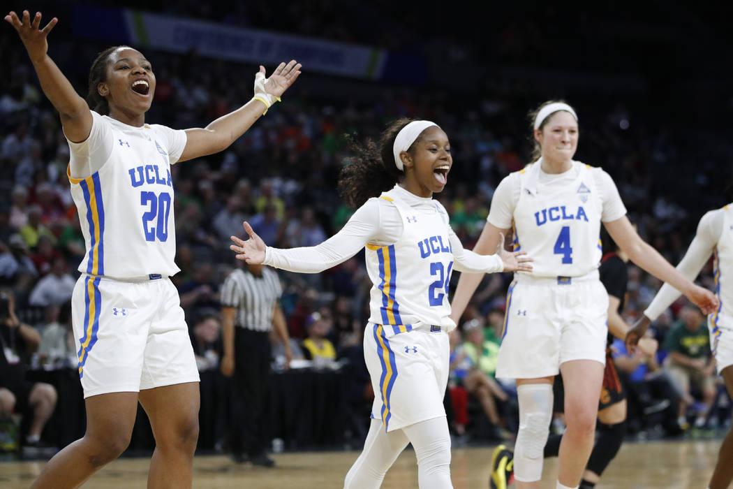 UCLA's Charisma Osborne, left, Japreece Dean, center, and Lindsey Corsaro celebrate after a pla ...