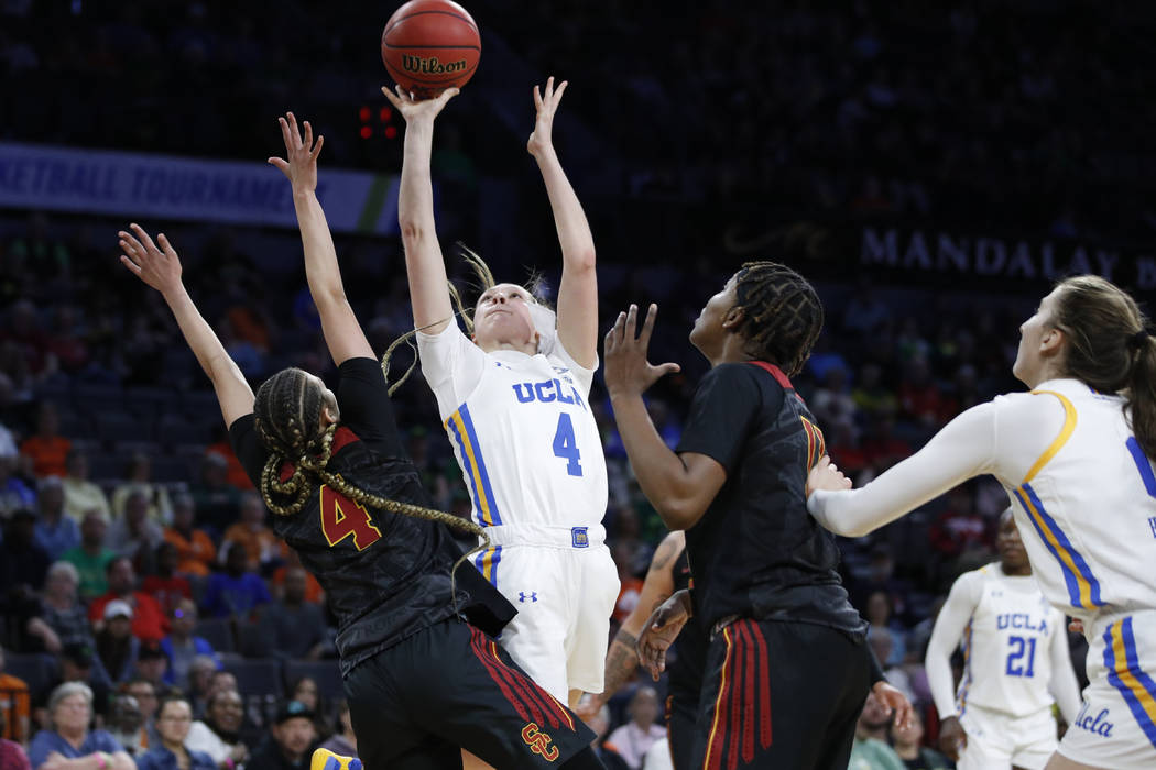 UCLA's Lindsey Corsaro shoots over Southern California's Endyia Rogers, left, during the second ...